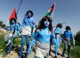 Palestinians dressed as the Na'vi from the film Avatar stage a protest Israeli Wall